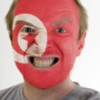 Face of crazy angry man painted in colors of Tunisia flag — Stock Photo #7338522