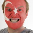 Face of crazy angry man painted in colors of Turkey flag — Stock Photo #7338551