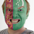 Face of crazy angry man painted in colors of Turkmenistan flag — Stock Photo #7338572