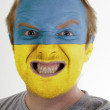 Face of crazy angry man painted in colors of Ukraine flag — Stock Photo #7338592