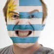 Face of crazy angry man painted in colors of Uruguay flag — Stock Photo #7338616