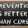 "Proverb ""Prevention is better than cure"" written on a blackboard — Stock Photo"