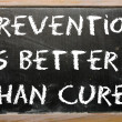 "Proverb ""Prevention is better thcure"" written on blackboard — Stock Photo #7338879"