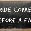 "Proverb ""Pride comes before a fall"" written on a blackboard — Foto Stock"