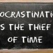 "Stock Photo: Proverb ""Procrastination is thief of time"" written on blac"