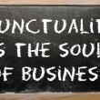 "Proverb ""Punctuality is the soul of business"" written on a black — Stock Photo"