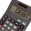 old calculator on white background showing text debit in persp — Stock Photo