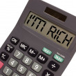"Old calculator on white background showing text ""I'm rich"" i — Stock Photo"