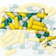 Outline map of Massachusetts with transparent pills in the backg — Stock Photo