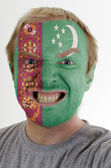 Face of crazy angry man painted in colors of Turkmenistan flag — Stock Photo