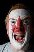 Cara de homem louco furioso pintado nas cores da bandeira do brasil — Fotografia Stock