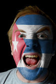 Face of crazy angry man painted in colors of Cuba flag — Photo