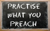 "Proverb ""Practise what you preach"" written on a blackboard — Stock Photo"