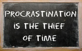 "Proverb ""Procrastination is the thief of time"" written on a blac — Stock Photo"