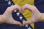 Heart and love gesture showed by hands over flag of bosnia herze — Stock Photo