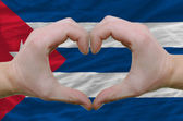 Heart and love gesture showed by hands over flag of cuba backgro — Stock Photo