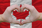 Heart and love gesture showed by hands over flag of canada backg — Stock Photo
