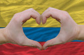 Heart and love gesture showed by hands over flag of columbia bac — Stock Photo