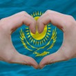Heart and love gesture showed by hands over flag of kazakstba — Stock Photo #7382002