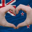 Stock Photo: Heart and love gesture showed by hands over flag of new zealand