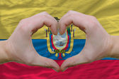 Heart and love gesture showed by hands over flag of ecuador back — Stock Photo