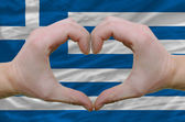 Heart and love gesture showed by hands over flag of greece backg — Stock Photo