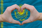 Heart and love gesture showed by hands over flag of kazakstan ba — Stock Photo
