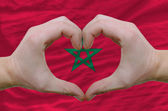 Heart and love gesture showed by hands over flag of morocco back — Stock Photo