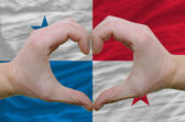 Heart and love gesture showed by hands over flag of panama backg — Stock Photo