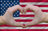 Heart and love gesture showed by hands over flag of usa backgrou — Stock Photo