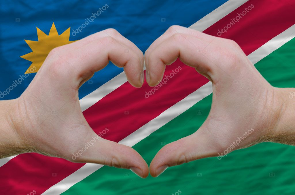 Gesture made by hands showing symbol of heart and love over namibia flag — Stock Photo #7382286