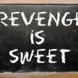 "Stock Photo: Proverb ""Revenge is sweet"" written on blackboard"