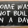 Proverb Rome was not built in a day written on a blackboard — Stockfoto