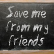 "Proverb ""Save me from my friends"" written on a blackboard — 图库照片"