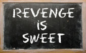 "Proverb ""Revenge is sweet"" written on a blackboard — Стоковое фото"