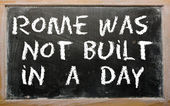 "Proverb ""Rome was not built in a day"" written on a blackboard — ストック写真"