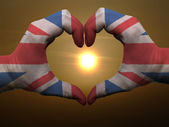 Heart and love gesture by hands colored in uk flag during beauti — Стоковое фото