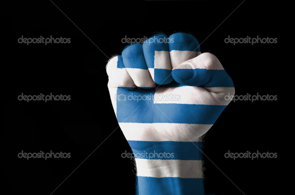 Low key picture of a fist painted in colors of greece flag — Stock Photo #7435473