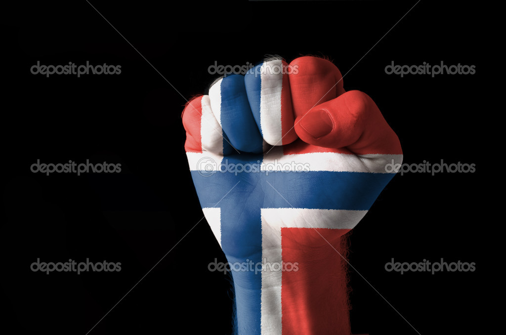 Low key picture of a fist painted in colors of norway flag — Stock Photo #7469672