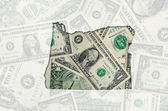 Outline map of oregon with transparent american dollar banknotes — Stock Photo