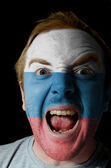 Face of crazy angry man painted in colors of russia flag — Stock Photo
