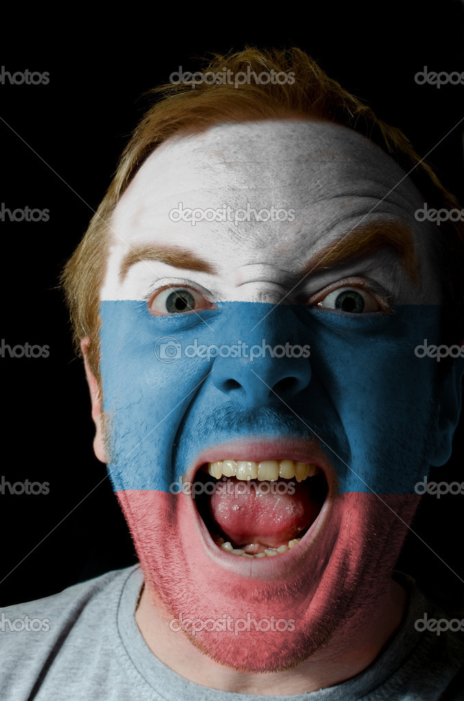 Low key portrait of an angry man whose face is painted in colors of russia flag — Stock Photo #7522270