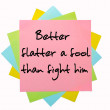 "Proverb ""Better flatter a fool than fight him"" written on bunch — Stock Photo"