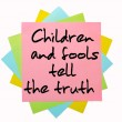 "Proverb ""Children and fools tell the truth"" written on bunch of — Stock Photo"