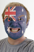 Face of crazy angry man painted in colors of australia flag — Stockfoto