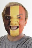 Face of crazy angry man painted in colors of belgium flag — Stock Photo