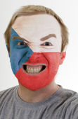 Face of crazy angry man painted in colors of czech flag — Stockfoto