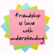 "Proverb ""  Friendship is love with understanding "" written on bu — Stock Photo"
