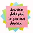 """Proverb """" Justice delayed is justice denied """" written on bunch o — Stock Photo"""