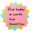 Постер, плакат: Proverb One today is worth two tomorrow written on bunch of